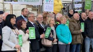 Protesters against the plan outside Warrington Town Hall