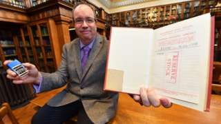 Librarian David Harrington with the copy of Geoffrey Faber's The Buried Stream which was returned to Middlesbrough's Central Library after nearly 58 years