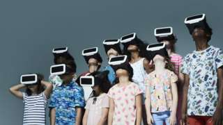 Kids and teenagers wearing VR headsets