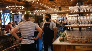 Bartenders wearing facemasks