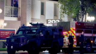 Police officers outside the building in Orange, California, on 31 March 2021