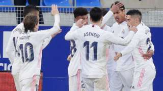 Real Madrid's players celebrate scoring against Huesca
