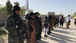 Taliban fighters by a checkpoint