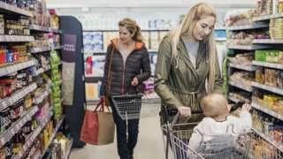 A mother with her baby shopping