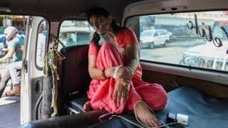 A Covid-19 patient on oxygen support waiting for admission amid a shortage of beds, at LNJP Hospital, on April 22, 2021 in New Delhi,