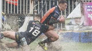 Castleford's Jake Trueman is tackled by Warrington's Toby King