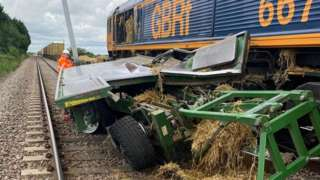 A tractor and freight train collided on a level crossing.