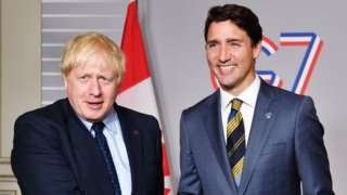 Prime Minister Boris Johnson meets Canadian Prime Minister Justin Trudeau at the G7 summit in Biarritz, France in 2019