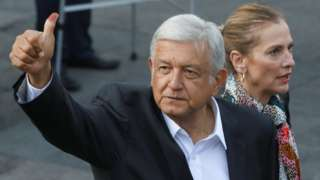 Presidential candidate Andres Manuel Lopez Obrador next to his wife Beatriz Gutierrez Muller gestures after casting his ballot at a polling station during the presidential election in Mexico City, Mexico July 1, 2018