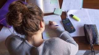 teenage girl at desk