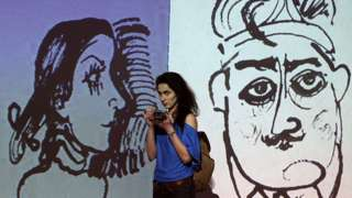 """MOSCOW, RUSSIA. FEBRUARY 11, 2016. A girl attends a multimedia exhibition of works by Georgian theatre and film director, playwright, writer, painter and sculptor Revaz """"Rezo"""" Gabriadze at the Museum of Moscow. The exhibition marks Gabriadze's 80th birthday"""