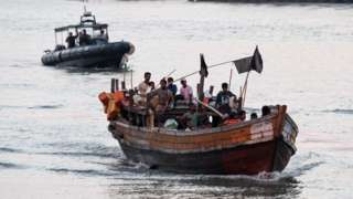 A wooden boat carrying Rohingya refugees children detained in Malaysia territorial waters off the island of Langkawi, 2018