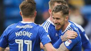 Joe Bennett celebrates after scoring Cardiff's third goal