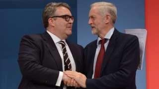 Tom Watson and Jeremy Corbyn shaking hands