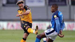 Nicky Maynard of Newport County has his shot at goal blocked by Aaron Hayden of Carlisle United