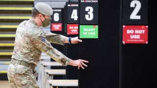 Members of the Royal Scots Dragoon Guard help set up a vaccination centre at the Ravenscraig Regional Sports Facility