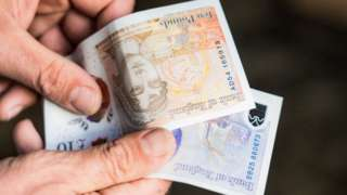 Hands with bank notes