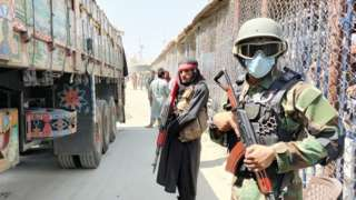 Taliban and Pakistani soldiers guard Afghanistan's border