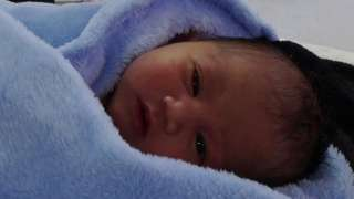 Newborn wrapped in a blanket