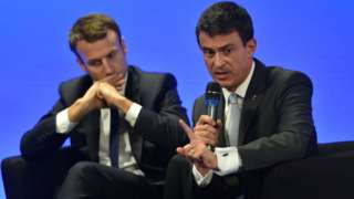 File pic 2015: French Economy and Industry minister Emmanuel Macron (L) and French Prime minister Manuel Valls in the French northern city of Boulogne-sur-Mer