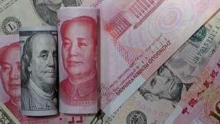 美元与人民币钞票(设计图片)