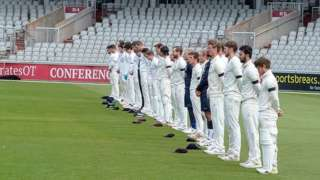 Lancashire and Surrey observe a two-minute silence