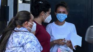 Sara Rogel talks whit relatives after being released from the Zacatecoluca Penal Center in Zacatecoluca, El Salvador