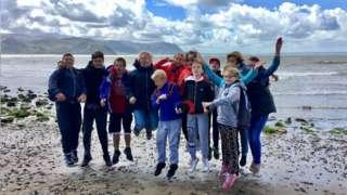 Children from Belarus playing on UK beach