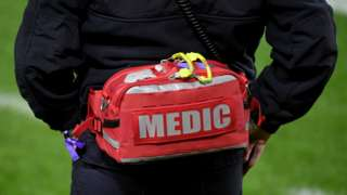 A medic with a first aid kit