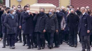 The coffin of Paolo Rossi leaves the Santa Maria Annunciata Cathedral in Vicenza, northeastern Italy
