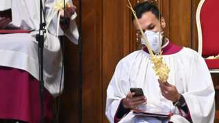 Vatican cleric in mask on Palm Sunday, 5 Apr 20