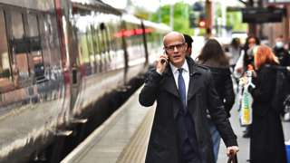 A man makes his way onto a train at Stoke-on-Trent Train Station on 20 May 2021 in Stoke, England