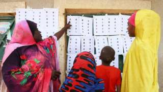 """People check voting lists during Nigeria""""s presidential election"""