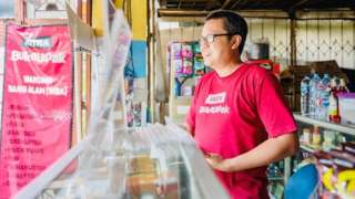 A bukalapak.com agent in his shop.