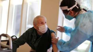 Donald Caster, 88, receives the coronavirus vaccine at Mission Commons assisted living community in Redlands, California