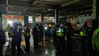 West Midlands Police officers at warehouse