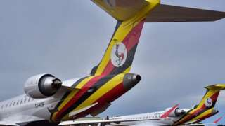 Bombardier CRJ900 planes with Ugandan flag and crest on them