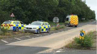 Police vehicles on the A33