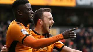 Alfred N'Diaye and Diogo Jota celebrate a Wolves goal