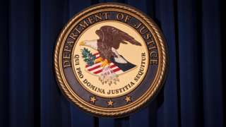 The Department of Justice (DOJ) official seal / emblem / logo is pictured on a wall in New York, United States