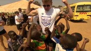 Adam Peaty with children in Zambia