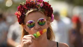 Woman with a lolly at a festival