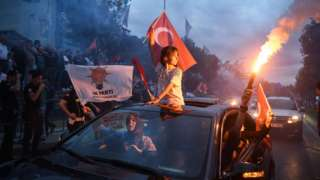 Supporters celebrate outside the AK party headquarters on June 24, 2018 in Istanbul, Turkey
