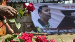 A Bangladeshi social activist pays his respects to Avijit Roy in Dhaka on March 6, 2015