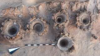 Undated image shows archaeologists discover a 5,000-year-old mass production brewery in the ancient city of Abydos at Sohag Governorate in Egypt, in this image released on February 13, 2021 by the Joint Egyptian-American Archaeology Mission Handout via Egypt's ministry of antiquities.