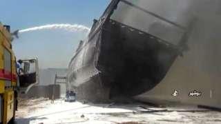 Screengrab taken from Iranian state TV showing ship on fire at shipyard in Bushehr, Iran (15 July 2020)