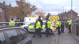 Police officers at the scene of the accident