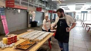 Volunteers make meals