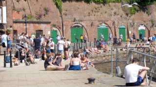 People on Exeter Quay