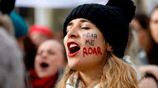 """A woman shouts slogans as demonstrators attend the """"March4Women"""" protest on International Women's Day in London, 8 March 2020"""